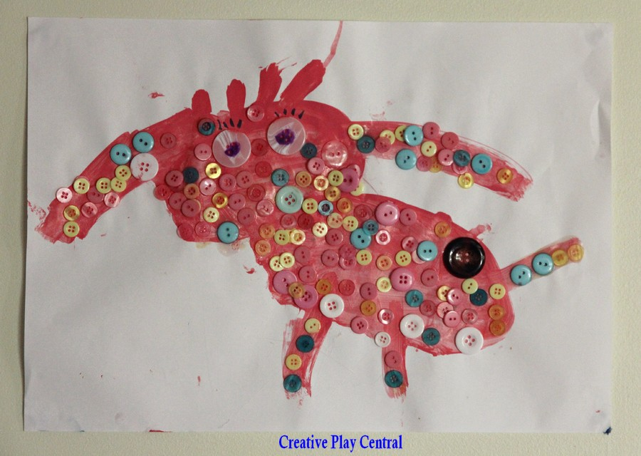 Picture 79 buttons, wool and paint pink dog