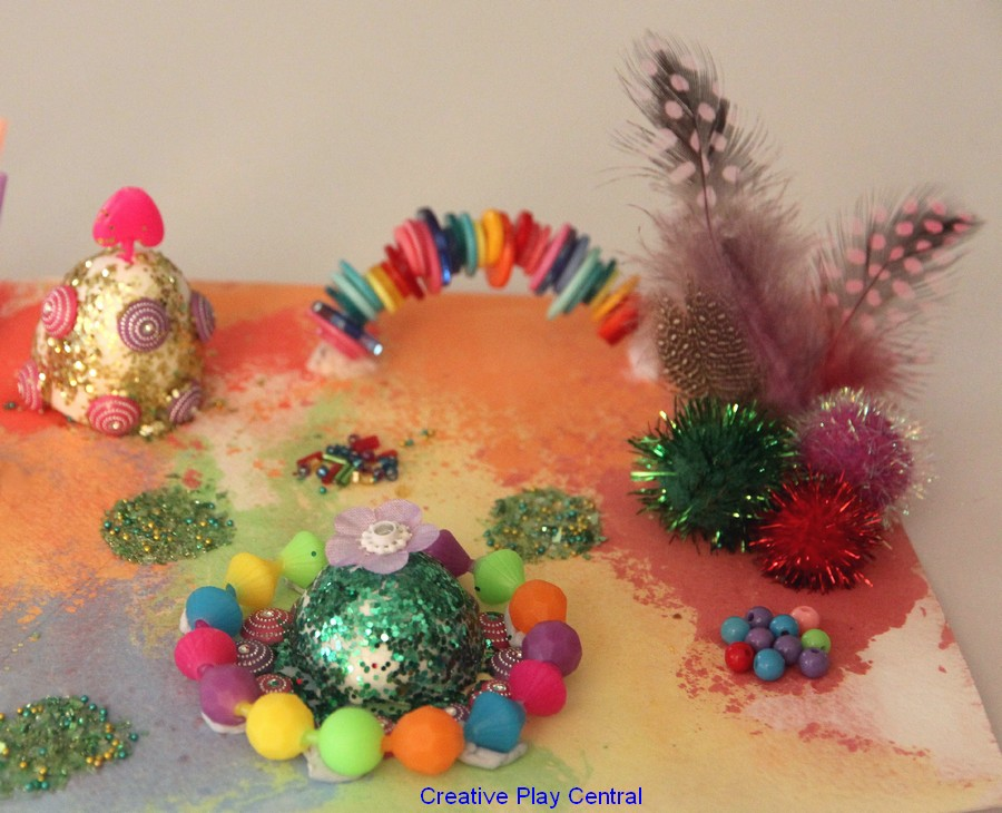 Recycling chalk prints - gold ball, rainbow buttons, feathers and glitter  green ball